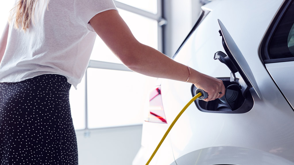 Woman Charging EV at Home