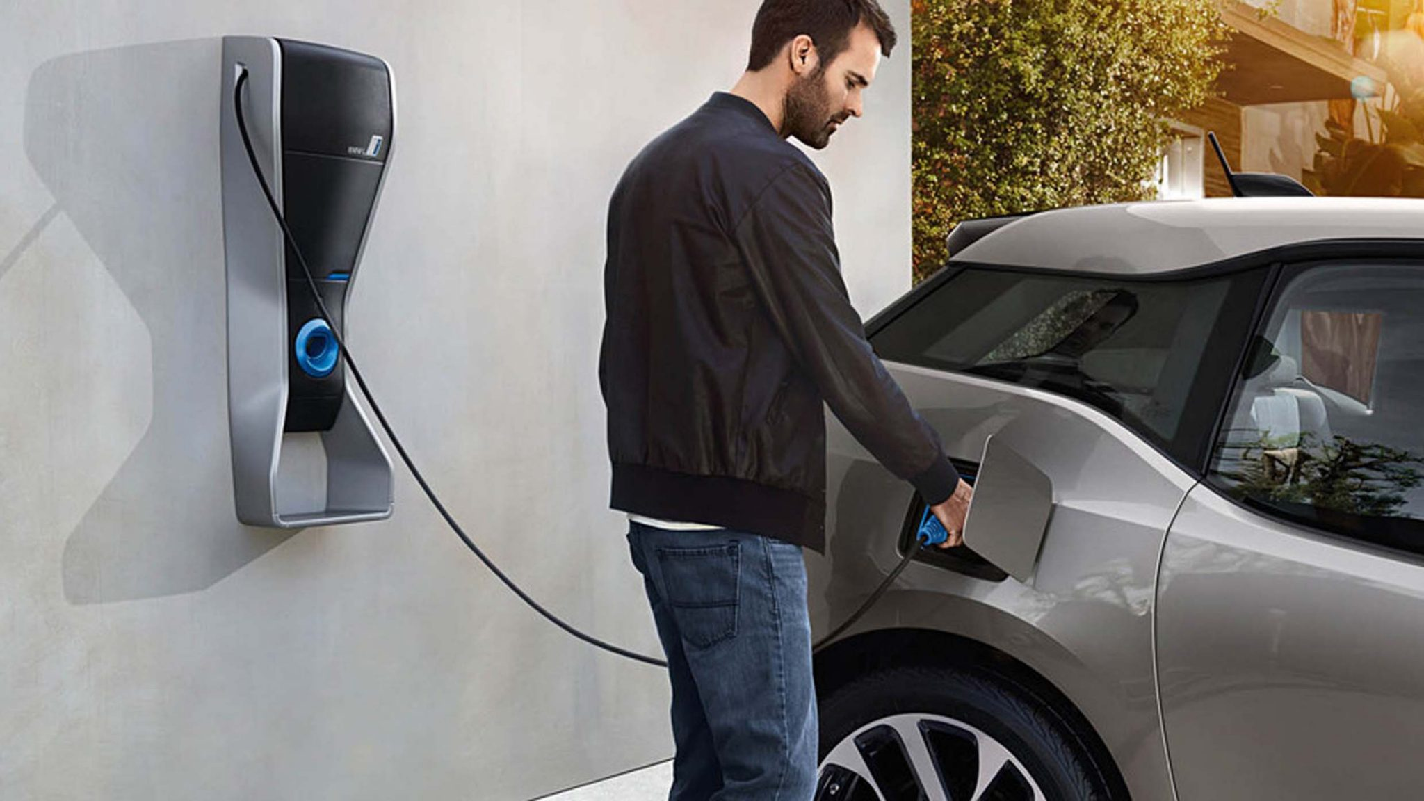 Person charging Electric Car