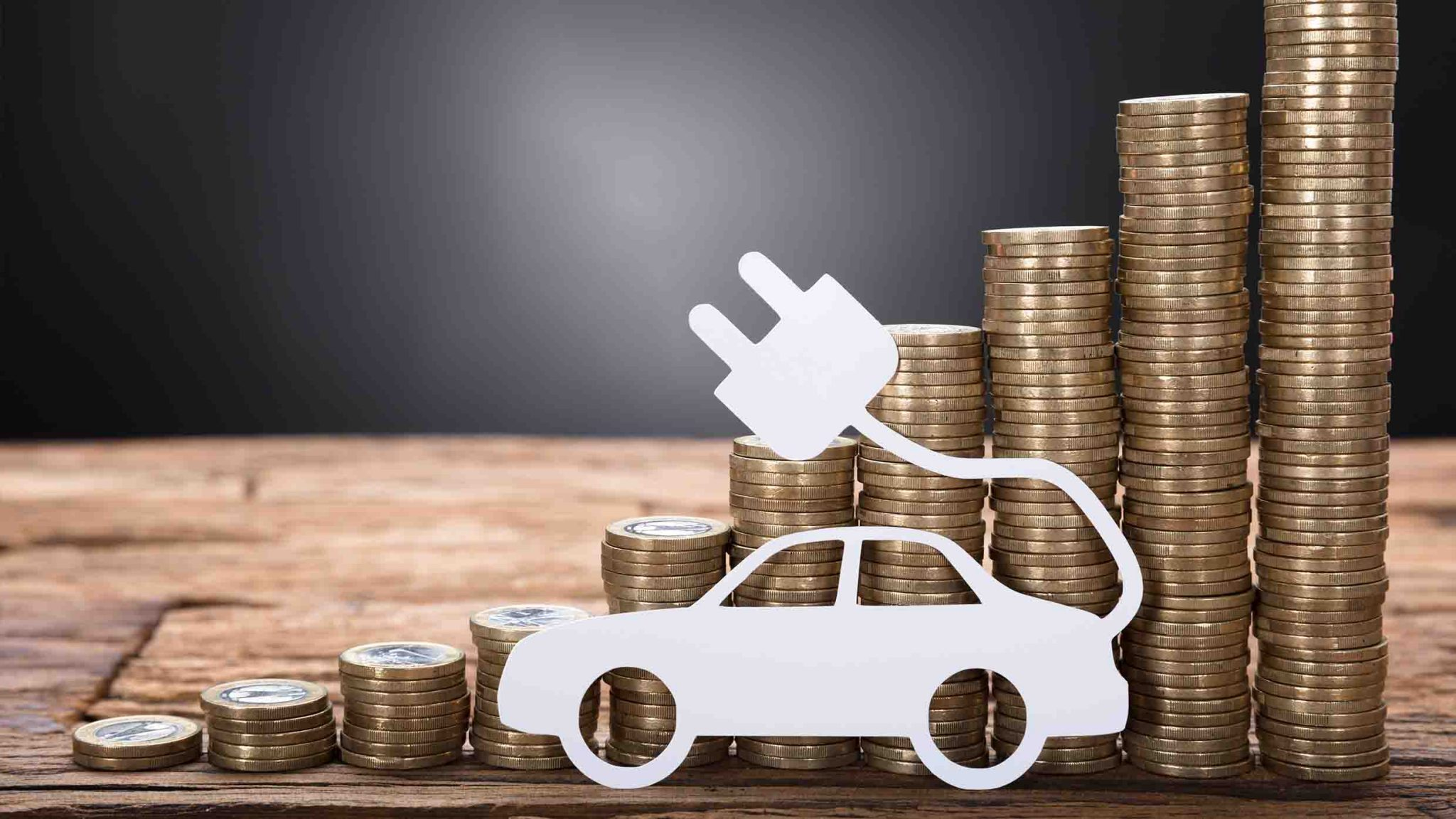 EV illustration and coins. Lower running costs.